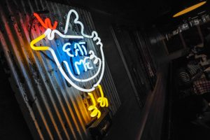 Gus's Fried Chicken Eat Me sign (Becky Stein Photography) Mall at Peachtree Center, on Friday October 16, 2015. Neon 'eat me' sign (Becky Stein Photography)