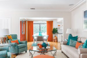 Mid Century Home with orange curtains. HausZwei Homes Kevin Polite Solid Source Realty, Inc.