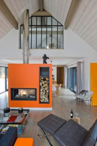 Mid Century Home with Modern fireplace painted orange HausZwei Homes Kevin Polite Solid Source Realty, Inc.