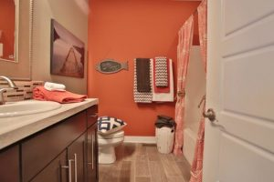 Mid Century Home with Modern wall painted orange HausZwei Homes Kevin Polite Solid Source Realty, Inc.