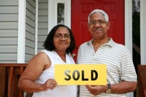 Happy Couple Sold Sign