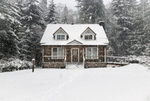House surrounded by Snow in the winter